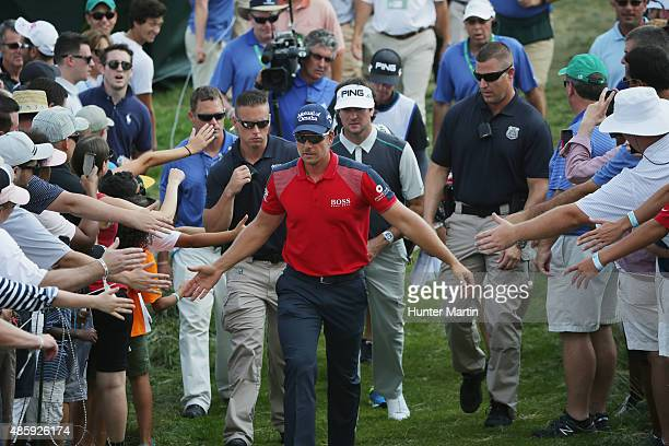 Henrik Stenson of Sweden and Bubba Watson of the United States walk to the ninth hole during the third round of The Barclays at Plainfield Country...