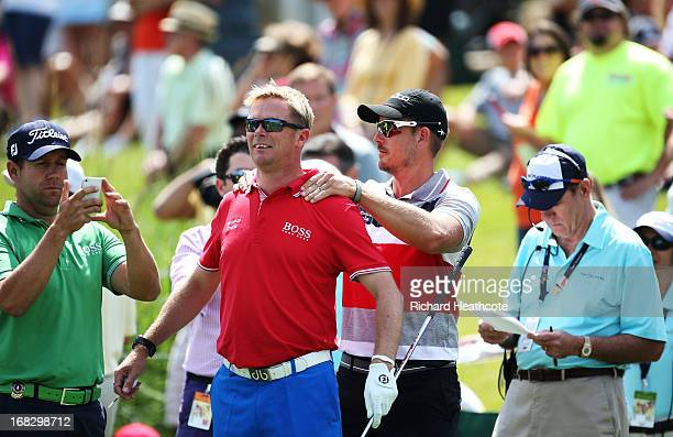 Henrik Stenson of Sweden and his caddie Gareth Bryn Lord prepare for the par 3, 17th hole during a caddy tournament prior to THE PLAYERS Championship...