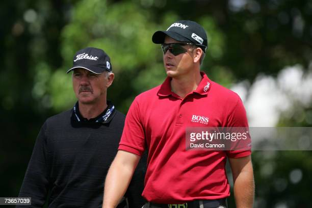 Henrik Stenson of Sweden and his coach Peter Cowen of England look over the eighth hole during final practice for the CA World Golf Championships...