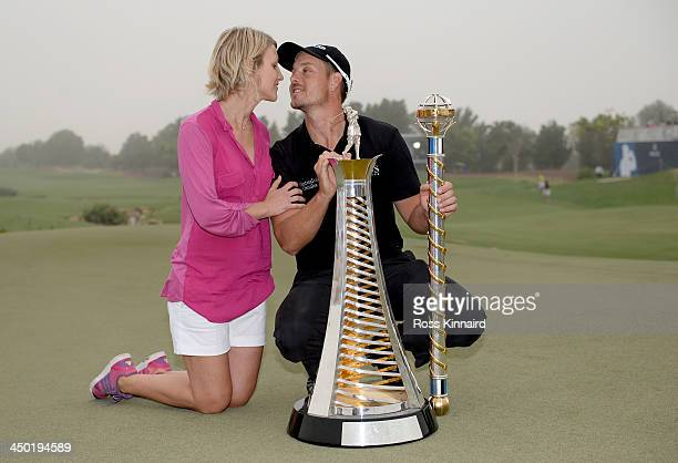 Henrik Stenson of Sweden and his wife Emma Stenson celebrate with the Race to Dubai and the DP World Championship trophies after the final round of...