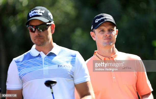 Henrik Stenson of Sweden and Justin Rose of England look on from the fifth tee during round two of the Abu Dhabi HSBC Golf Championship at Abu Dhabi...