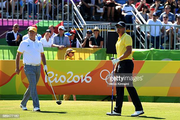 Henrik Stenson of Sweden and Marcus Fraser of Australia look on from the fist tee during the final round of golf on Day 9 of the Rio 2016 Olympic...