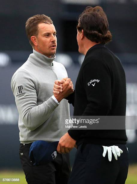 Henrik Stenson of Sweden and Phil Mickelson of the United States shake hands after their round the 18th green during the third round on day three of...