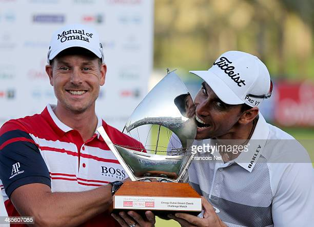 Henrik Stenson of Sweden and Rafa CabreraBello of Spain with the trophy that they shared after finishing on six under par during the Champions...