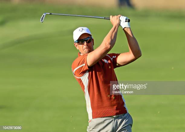 Henrik Stenson of Sweden and the European Team plays his second shot on the 17th hole in his match with Justin Rose against Brooks Koepka and Dustin...