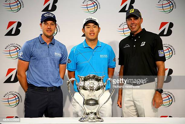 Henrik Stenson of Sweden ByeongHun An of South Korea and Matt Kuchar of the USA pose with the trophy won by George Lyon of Canada at the 1904...