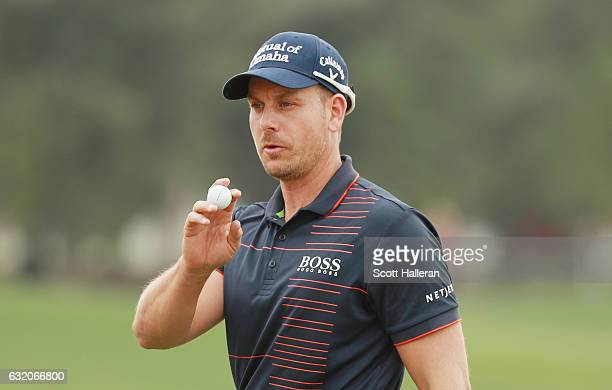 Henrik Stenson of Sweden celebrates a birdie putt on the ninth hole during the first round of the Abu Dhabi HSBC Championship at Abu Dhabi Golf Club...