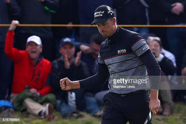 Henrik Stenson of Sweden celebrates a putt on the 14th during the final round on day four of the 145th Open Championship at Royal Troon on July 17...
