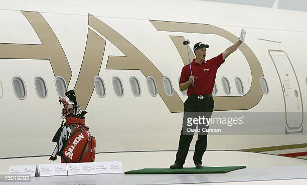Henrik Stenson of Sweden celebrates his longest drive of 721 yards during the 'Etihad Airways Swing on the Wing Challenge' while standing on a...