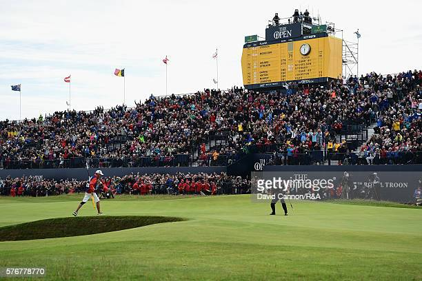 Henrik Stenson of Sweden celebrates on the 18th green after holing a putt for victory during the final round on day four of the 145th Open...