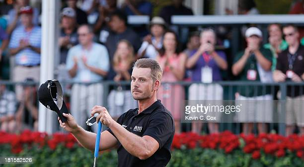 Henrik Stenson of Sweden celebrates on the 18th green after winning the TOUR Championship by CocaCola and the FedExCup Playoffs at East Lake Golf...