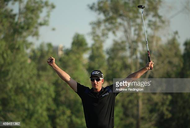 Henrik Stenson of Sweden celebrates on the 18th hole after winning the DP World Tour Championship at Jumeirah Golf Estates on November 23 2014 in...