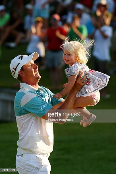 Henrik Stenson of Sweden celebrates on the 18th hole with his daughter Lisa after finishing the final round of THE PLAYERS Championship on THE...