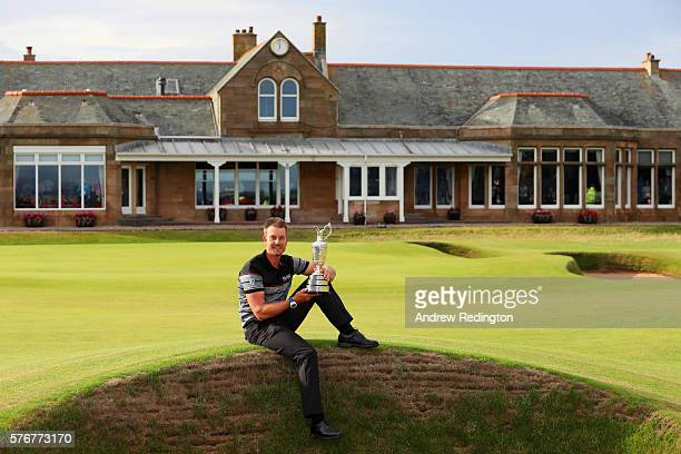 Henrik Stenson of Sweden celebrates victory as he poses with the Claret Jug on the the 18th green after the final round on day four of the 145th Open...