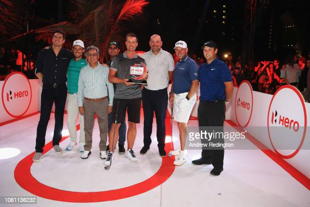 Henrik Stenson of Sweden celebrates with Pawan Munjal Chairman of Hero MotoCorp after wins the DP World Tour Championship Hero Challenge held at...