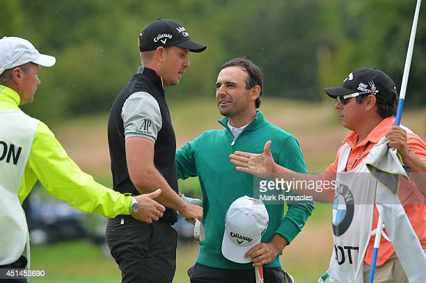 Henrik Stenson of Sweden concedes the play off match to Fabrizio Zanotti of Paraguay on the 17th green during the BMW International Open at Golf Club...