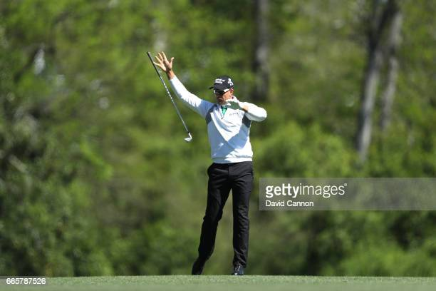 Henrik Stenson of Sweden drops his club after plays his second shot on the fifth hole hitting during the second round of the 2017 Masters Tournament...