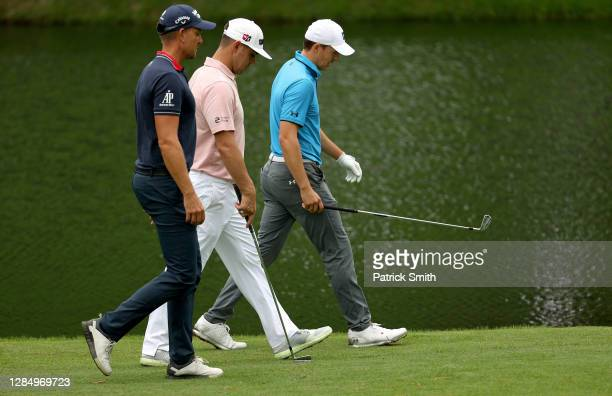 Henrik Stenson of Sweden, Gary Woodland of the United States and Jordan Spieth of the United States walk during a practice round prior to the Masters...