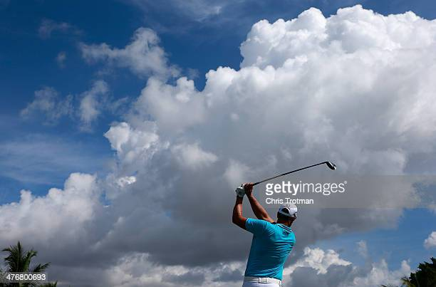 Henrik Stenson of Sweden hits a pitch shot during a practice round prior to the start of the World Golf Championships-Cadillac Championship at Trump...