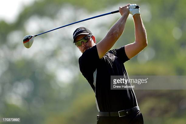 Henrik Stenson of Sweden hits a tee shot during a practice round prior to the start of the 113th U.S. Open at Merion Golf Club on June 12, 2013 in...