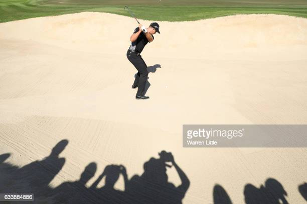 Henrik Stenson of Sweden hits from a bunker on the 10th hole during the final round of the Omega Dubai Desert Classic at Emirates Golf Club on...
