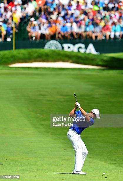 Henrik Stenson of Sweden hits his approach on second hole during the final round of the 95th PGA Championship at Oak Hill Country Club on August 11...