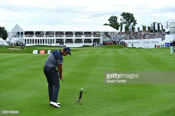 Henrik Stenson of Sweden hits his approach shot to the 18th green during the final round of the BMW International Open at Gut Larchenhof on June 26...