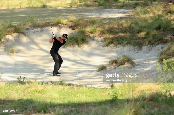 Henrik Stenson of Sweden hits his second shot from a bunker on the eighth hole during the final round of the 114th US Open at Pinehurst Resort...