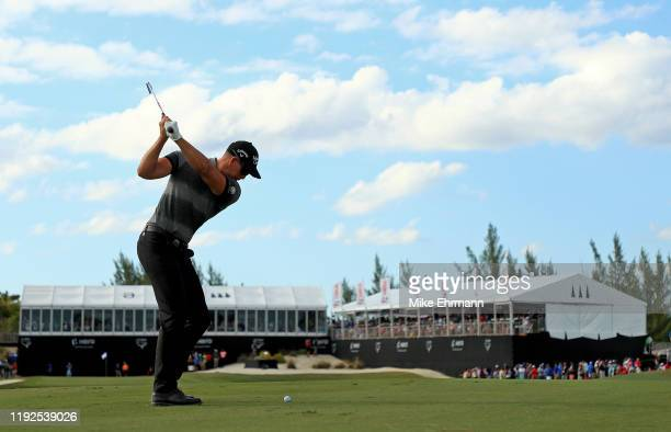 Henrik Stenson of Sweden hits is approach shot on the 18th hole during the final round of the Hero World Challenge at Albany on December 07, 2019 in...