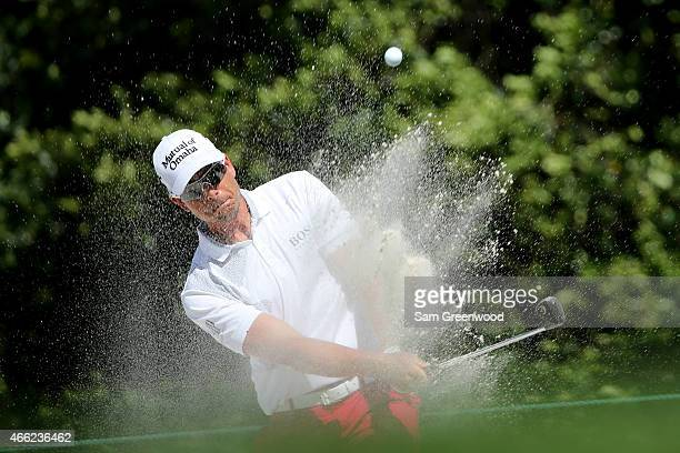 Henrik Stenson of Sweden hits out of a bunker on the seventh hole during the third round of the Valspar Championship at Innisbrook Resort Copperhead...