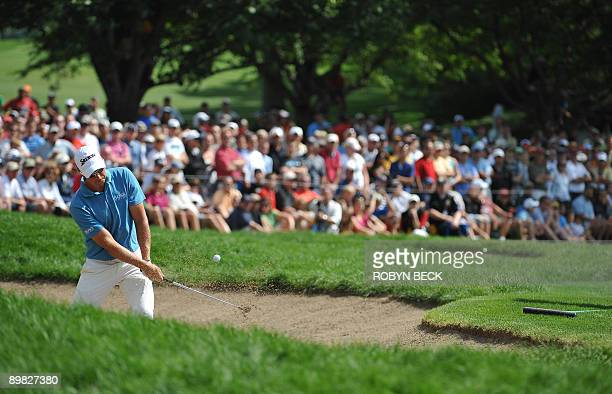Henrik Stenson of Sweden hits out of a sand bunker during the final round of the 91st PGA Championship at the Hazeltine National Golf Club in Chaska,...