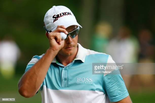 Henrik Stenson of Sweden holds up his ball after making birdie on the 15th hole during the final round of THE PLAYERS Championship on THE PLAYERS...