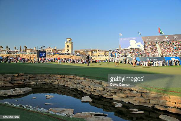 Henrik Stenson of Sweden holes the winning putt to secure his two shot victory during the final round of the 2014 DP World Tour Championship at...