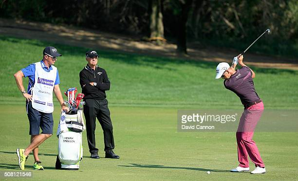 Henrik Stenson of Sweden is closely wached by his coach Pete Cowen during the proam as a preview for the 2016 Omega Dubai Desert Classic on the...