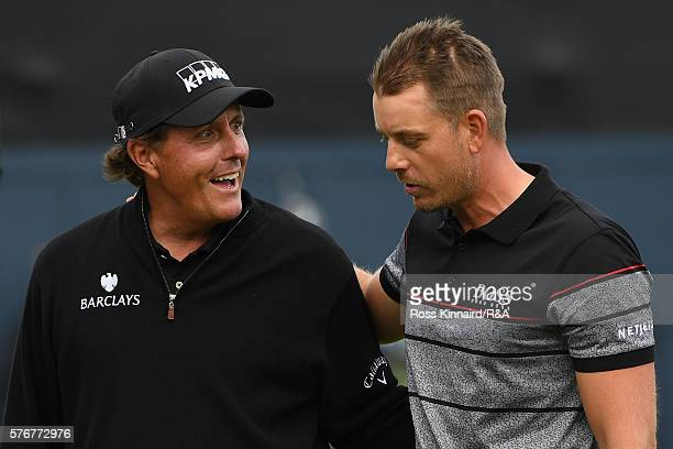 Henrik Stenson of Sweden is congratulated by Phil Mickelson of the United States on the 18th green during the final round on day four of the 145th...