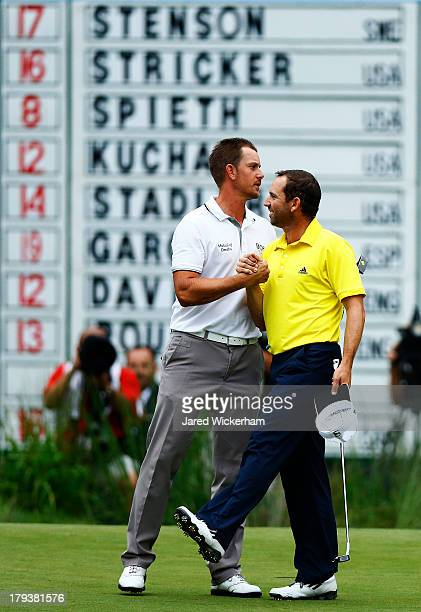 Henrik Stenson of Sweden is congratulated by Sergio Garcia of Spain after winning the Deutsche Bank Championship at TPC Boston on September 2, 2013...