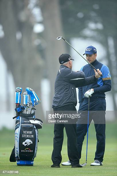 Henrik Stenson of Sweden is given some advice by his coach Pete Cowen of England during the proam as a preview for the World Golf Championships...