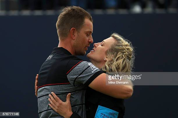 Henrik Stenson of Sweden kisses wife Emma in celebration after the winning putt during the final round on day four of the 145th Open Championship at...