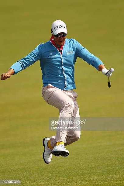 Henrik Stenson of Sweden leaps the Swilken Burn on the first hole during the final round of the 139th Open Championship on the Old Course St Andrews...