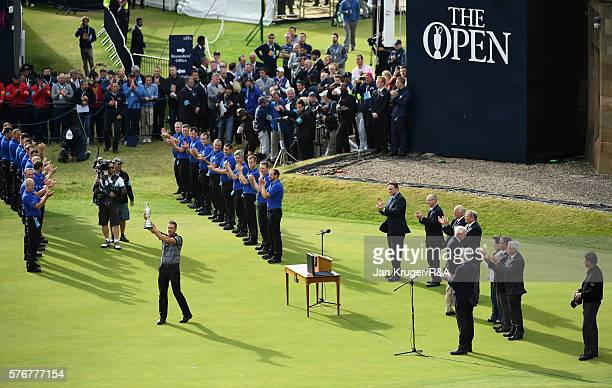 Henrik Stenson of Sweden lifts the Claret Jug following his victory during the final round on day four of the 145th Open Championship at Royal Troon...