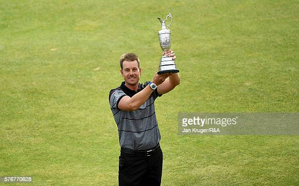 Henrik Stenson of Sweden lifts the Claret Jug on the 18th green following his victory during the final round on day four of the 145th Open...
