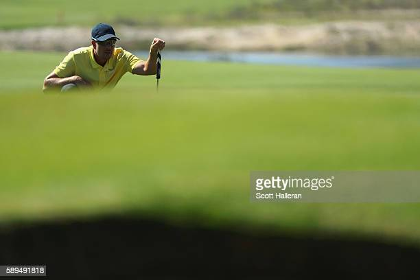 Henrik Stenson of Sweden lines up a putt on the tenth green during the final round of men's golf on Day 9 of the Rio 2016 Olympic Games at the...