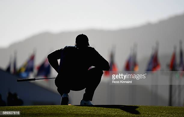 Henrik Stenson of Sweden lines up his putt on the par five 18th hole during the third round of the Mens Individual Stroke Play event on Day 8 of the...