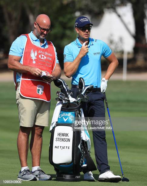 Henrik Stenson of Sweden looks on with his caddie during Day Two of the Abu Dhabi HSBC Golf Championship at the Abu Dhabi Golf Club on January 17...
