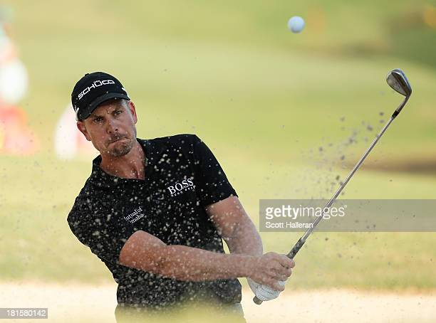 Henrik Stenson of Sweden plays a bunker shot on the 18th hole during the final round of the TOUR Championship by CocaCola at East Lake Golf Club on...