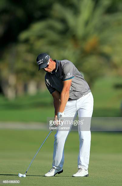 Henrik Stenson of Sweden plays a midiron for his second shot to the par 4 14th hole sequence #frame 9 during the second round of the World Golf...