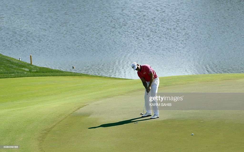 Henrik Stenson of Sweden plays a shot during the 2nd round of the 2016 Dubai Desert Classic at the Emirates Golf Club in Dubai on February 5, 2016. / AFP / KARIM
