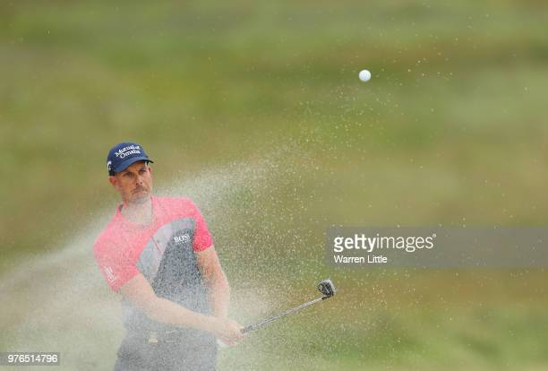 Henrik Stenson of Sweden plays a shot from a bunker on the 15th hole during the third round of the 2018 US Open at Shinnecock Hills Golf Club on June...
