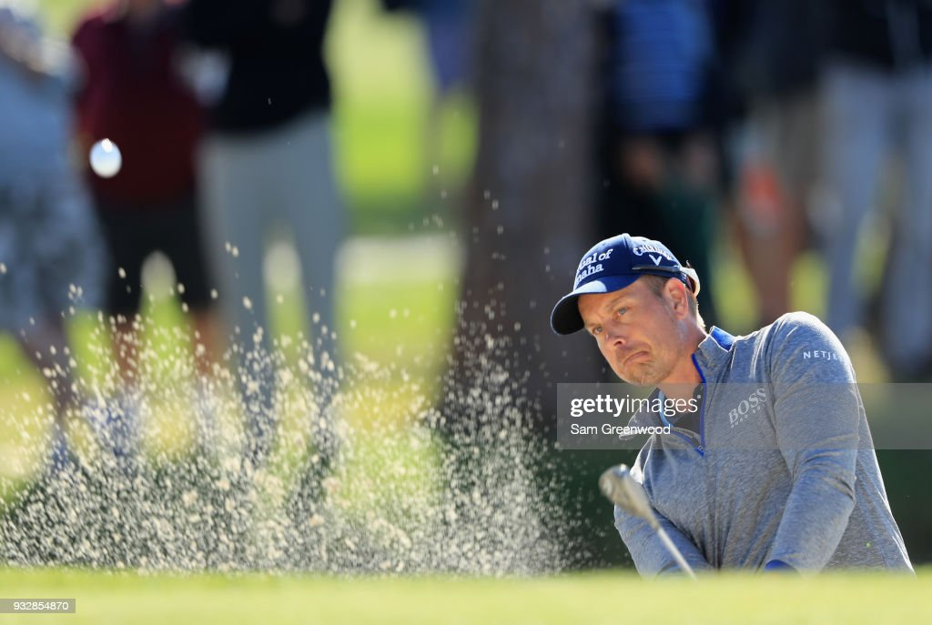 Henrik Stenson of Sweden plays a shot from a bunker on the 17th hole during the second round at the Arnold Palmer Invitational Presented By MasterCard at Bay Hill Club and Lodge on March 16, 2018 in Orlando, Florida.