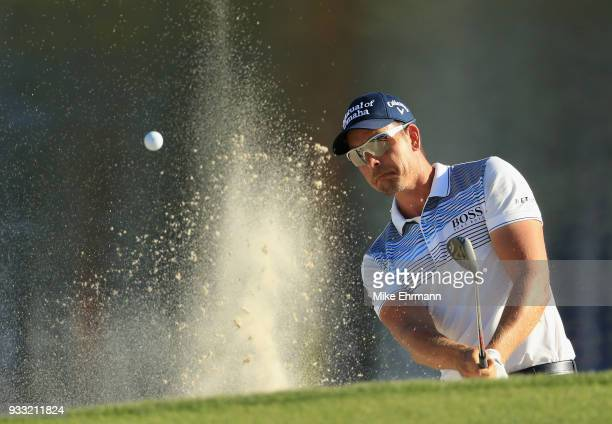 Henrik Stenson of Sweden plays a shot from a bunker on the 17th hole during the third round at the Arnold Palmer Invitational Presented By MasterCard...